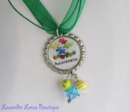 Autism Awareness -Spell it Out-autism, awareness, bottlecap, necklace, support, gift, bead, silver, crystal, lucite, green, ribbon, ballchain, gift, puzzle piece, autism awareness, bottlecap necklace, bottlecap gifts, support autism awareness
