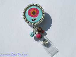 Pink n' Blue Posie-retractable, badge, reel, id, holder, credentials, flower, posie, blue, green, brown, beads, badge reel, id reel, id holder, credential holder, fun badge reel, fun id reel, beaded badge reel, beaded id reel, beaded credentials holder, flower credenital holder, retractable badge reel, retractable id reel, retractable id holder, nurse badge reel, teacher badge reel, office badge reel, badge reel gifts, id reel gifts, bottlecap badge reels